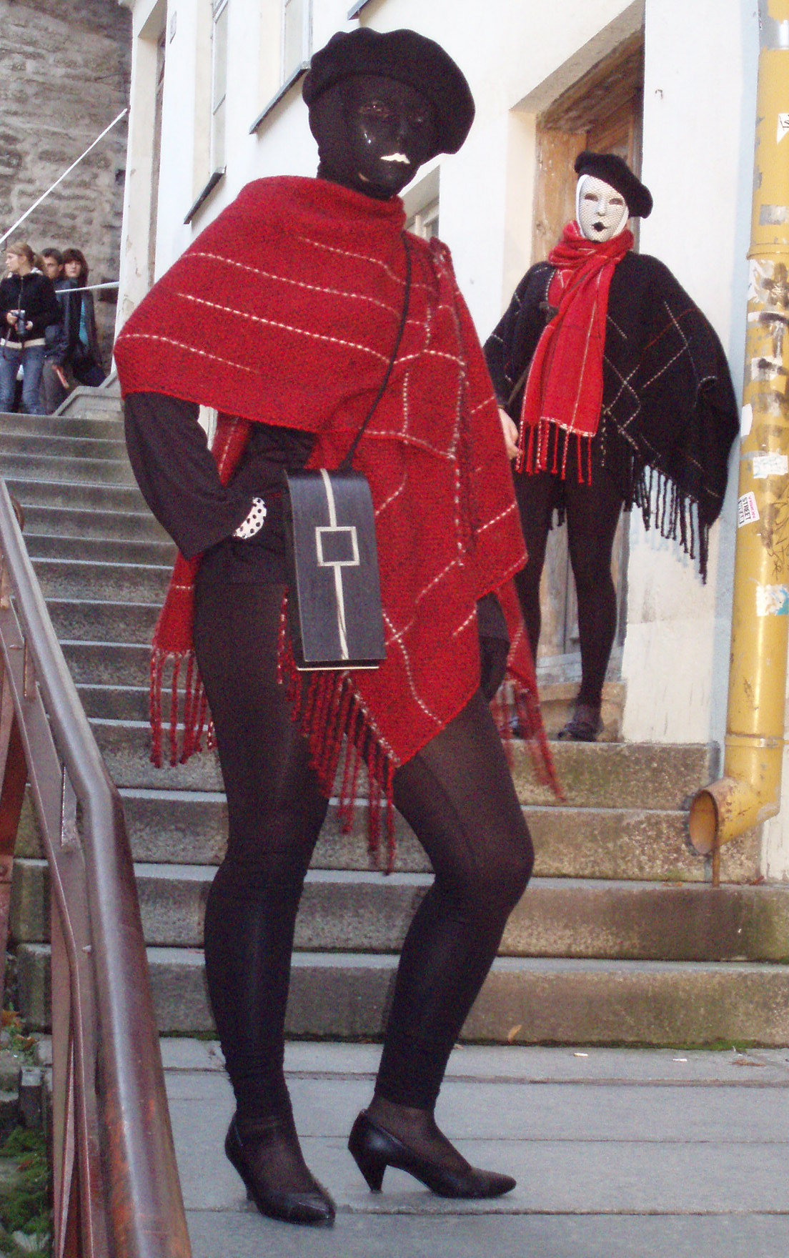 model wearing a black wooden intarsia bag with an outline of a square and a vertical stripe