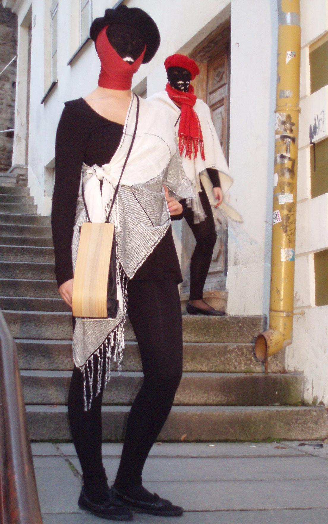 model wearing a light wooden bag