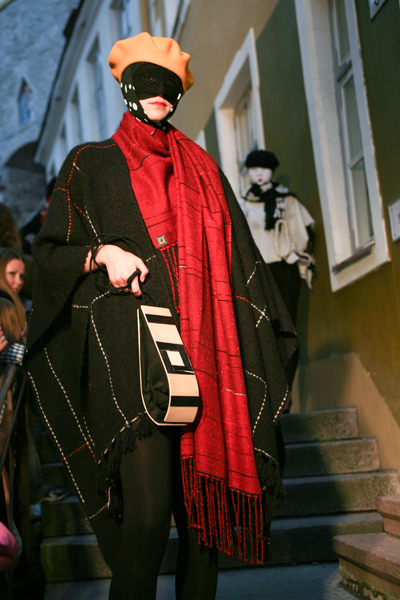 model holding a wooden intarsia bag with a strong black outline of a square and 2 horizontal stripes