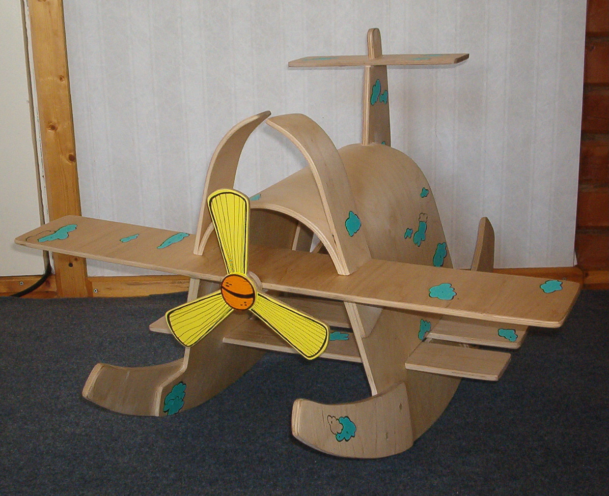 wooden plane with cartoonish décor