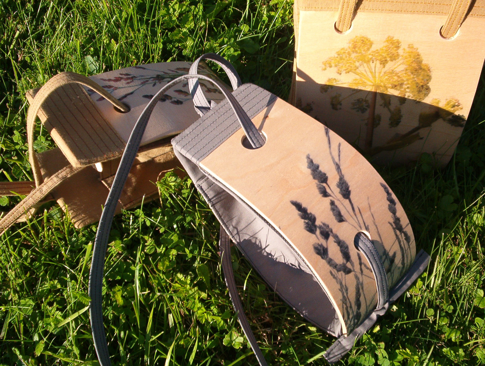 three wooden bags